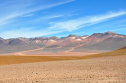 colorful lagunas in the andes mountains region of bolivia and peru, driving off road through deserts and salar de uyuni to la paz