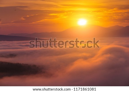 Colorful landscape in mountains with fog and sun #1171861081