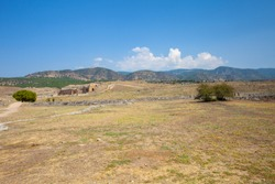Colorful landscape with the ruins of the ancient city of Hierapolis in Turkey.