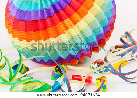 Colorful lantern with streamers and noisemaker