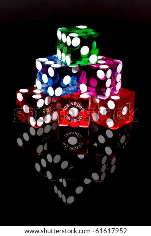 Colorful Las Vegas Craps or Gambling Dice on a black background.