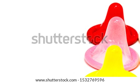 Colorful latex condom on white background, condom safe sex concept on the bed Prevent infection or sexually transmitted disease such as HIV and control the probability of pregnancy, Valentine's Day, #1532769596