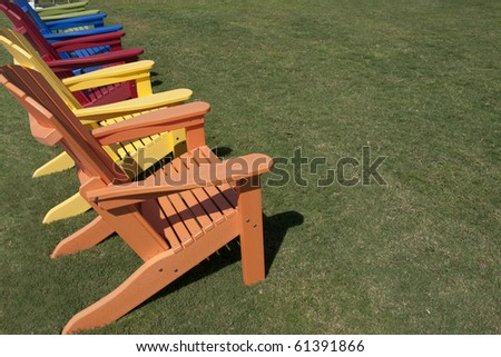 colorful lawn chairs sitting on green grass