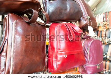 Colorful leather purses, handbags, wallets and handbags are displayed by street a Lorenzo Market, in Florence, Italy
