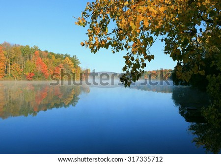 Photo of Colorful leaves reflected on Lake Laurel. Photographed in Lee, MA in Oct 2014.
