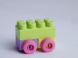 Colorful Lego Plastic Building Blocks with Wheels on White Background