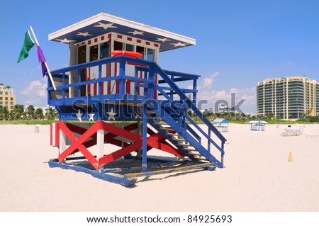 Colorful lifeguard hut painted red, white and blue in popular South Beach in Miami.