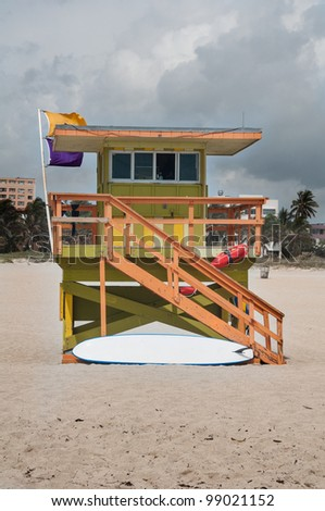 Colorful lifeguard shack by the ocean  on the beach during summer time