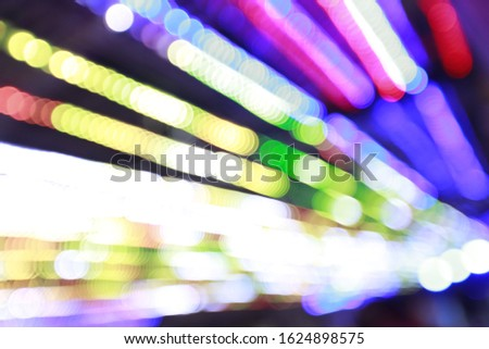 Colorful light Abstract lightbulb and bokeh blur background with motion blur.