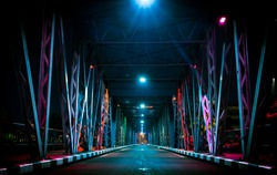 Colorful light on Iron Bridge at night time in Chiang mai, Thailand