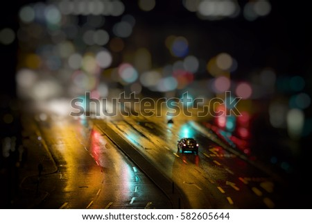 colorful light trace from night traffic in the city  #582605644