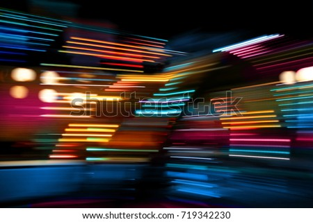 Colorful lights of urban city surrounding moving and blurred by motion