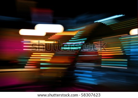 Colorful lights of urban surrounding blurred by motion - stock photo