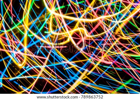 Colorful lights on the long exposure with motion background, Abstract glowing colorful lines, slow speed shutter