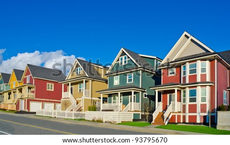 Colorful line of single homes in great neighborhood. The homes  in north America. Vancouver.