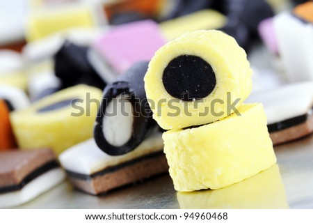 colorful liquorice candies on tray, on white background