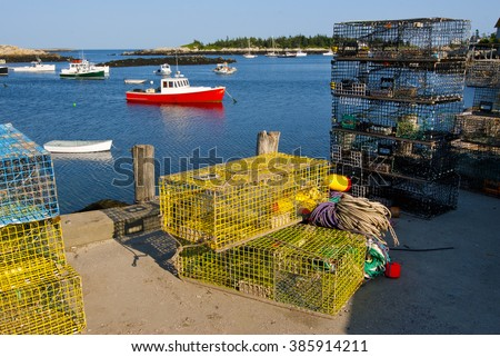 Colorful lobster traps align the dock for lobster boats moored at Matinicus Harbor, in Maine.