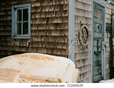 Colorful lobsterman shack with well worn and weathered shingles - stock photo