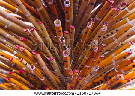 Colorful locally made bamboo flutes kept for sale,Bamboo Flutes background,texture #1168717864