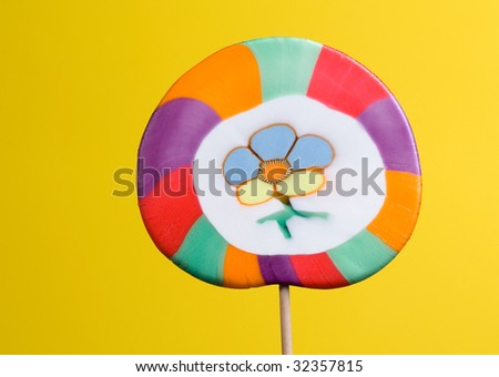 colorful lollipop over yellow background