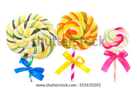 Colorful lollipops with ribbons isolated on white