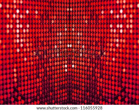 Colorful, luxurious, deep red sequins background.