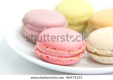 Colorful Macaron in close up isolated on white background