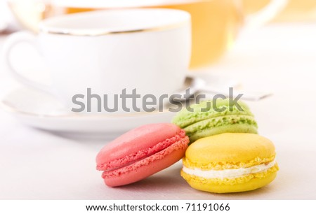 Colorful macaron with a cup of tea - Focus on the yellow one