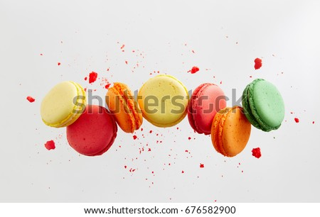 Colorful macarons cakes. Small French cakes. Sweet and colorful french macaroons falling or flying in motion. #676582900
