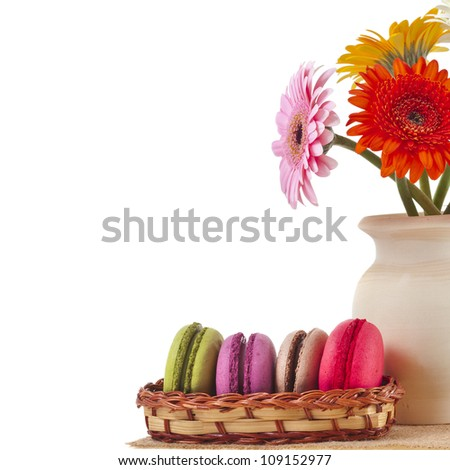 Colorful macaroons and bouquet gerber  isolation on a white background