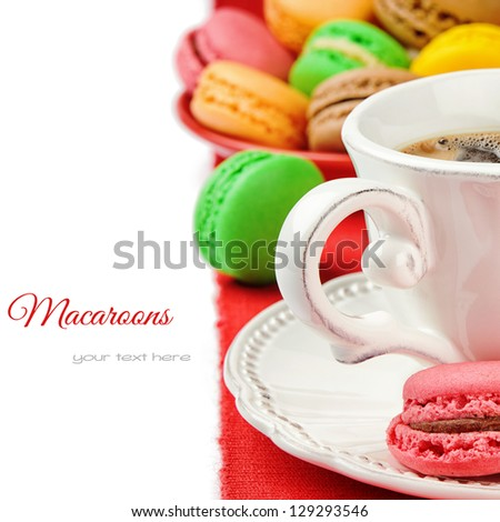 Colorful macaroons and coffee isolated over white