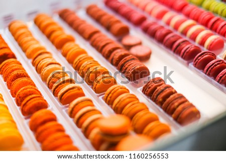 Colorful Macaroons. tasty French macaroon chef table. macaroons for dessert at pastry confectionary shop in Paris. art of making macaroons