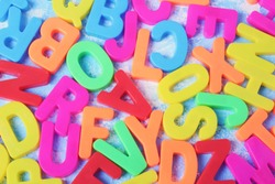 Colorful magnetic letters on a blue background.alphabet  background. back to school