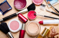 colorful makeup items scattered across a wooden surface