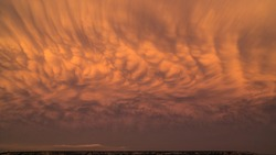 Colorful mammatus clouds during sunset in Texas.