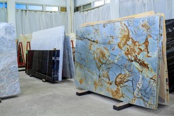 Colorful marble slabs in store show room. Quartzite slabs are prepared for sale in store yard