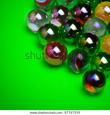 Colorful marbles over green background