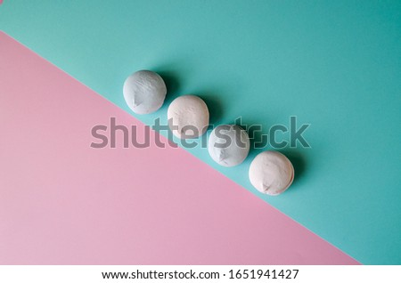 Colorful marshmallows on vibrant background. Pink, purple sweets, candy shop, trendy photography for design, place for text. Confectionery wallpaper