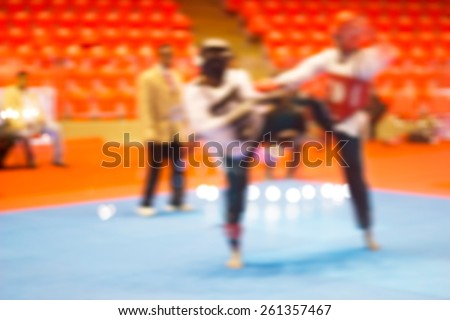 colorful martial arts fighting in indoor stadium, soft and blur concept