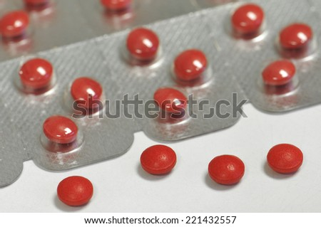 colorful medical therapy with different tablets, pills and capsules