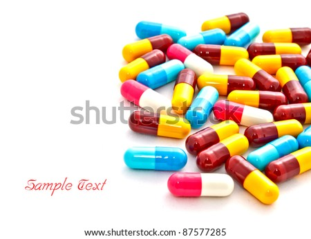 colorful medicine pills on white background