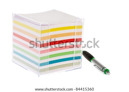 Colorful memo block with papers in plastic holder