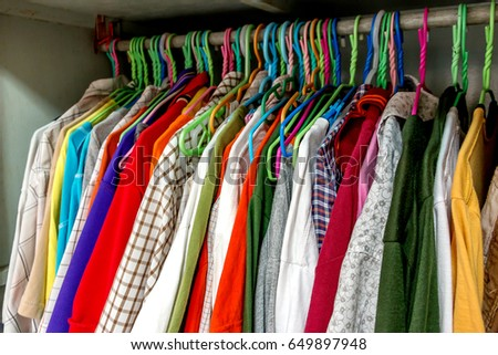 Colorful Men Clothing Hanging In Closet