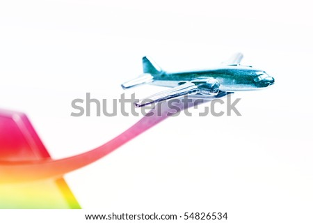 Colorful metallic small airplane against background