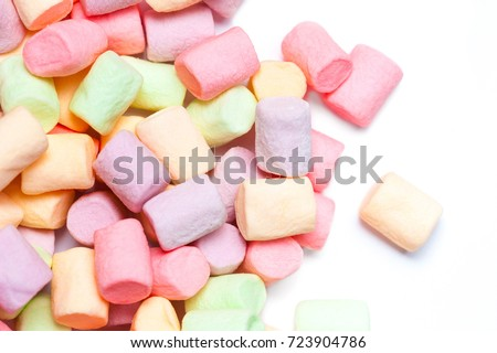 Colorful mini marshmallows isolated on white background, macro. Fluffy marshmallows texture and pattern. High Resolution image #723904786