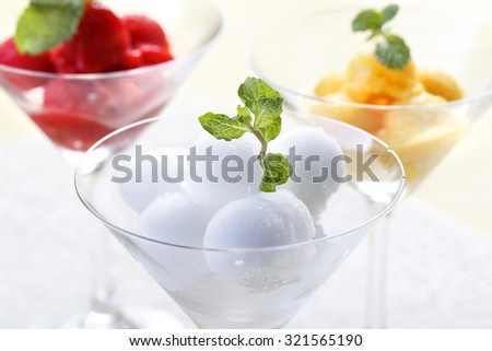 Colorful Mix fruit sorbet in cocktail glass.