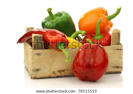 colorful mix of paprika's(capsicum) in a wooden box on a white background