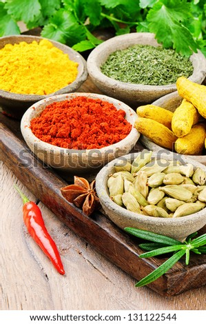 Colorful mix of spices on wooden table