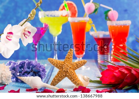 colorful mixed cocktails in tropical blue wood flowers starfish