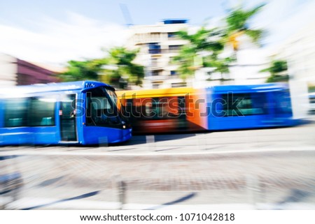 Colorful modern trams are moving on the line of Santa Cruz de Tenerife, Canary Island, Spain #1071042818